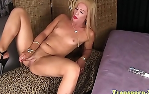 Teasing tranny playing with her cock