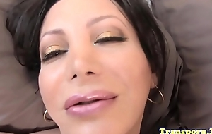 Bigtitted tranny tugs and strokes her dick